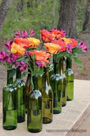 Liquor bottle centerpieces for an estival outdoor celebration.