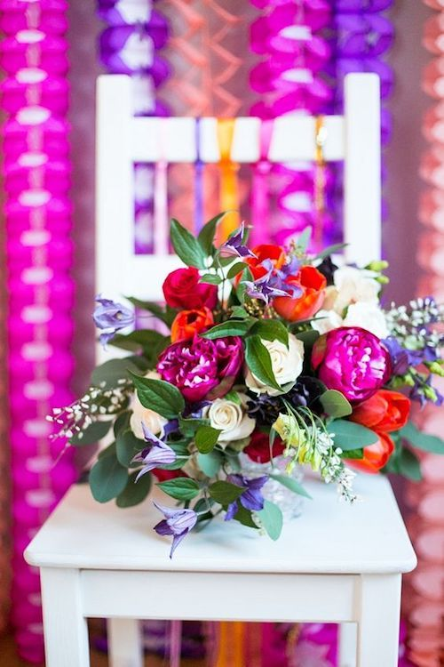 Coral, fuchsia and radiant orchid brightly colored summer centerpiece.