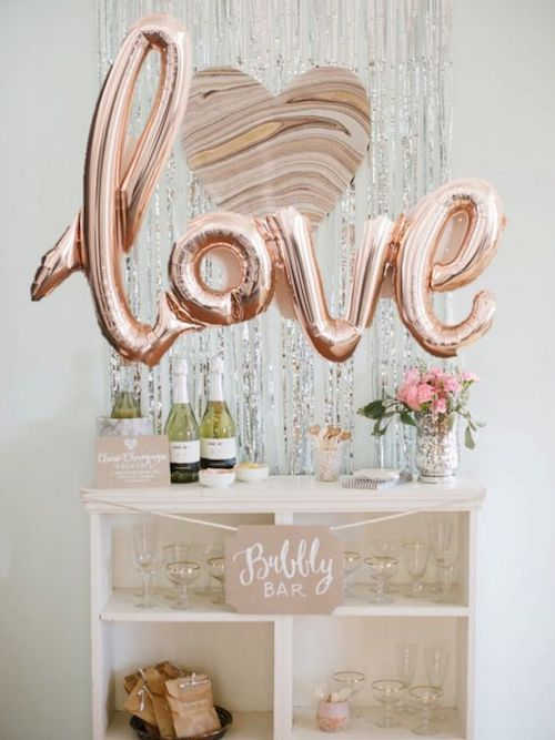 Take the bubbly bar to new heights with a love mylar balloon.