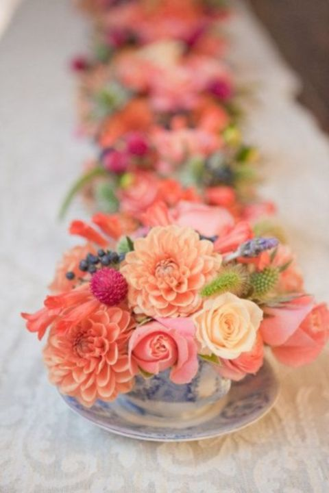Replace the table runner for a line up of vintage cups and saucers filled with soft coral flowers and lavender sprigs.