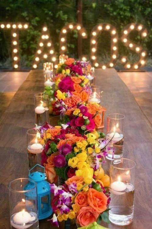 Stunning runner made of floral centerpieces.