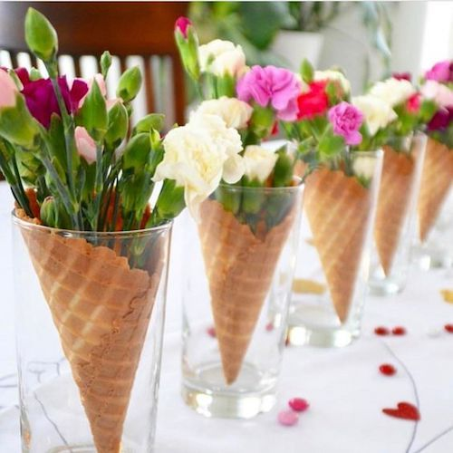 Such a lovely idea for your tablescape. Colorful flowers in ice cream cones.