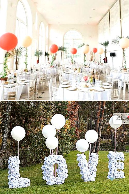 Garlands and giant colored balloons. Lovely balloons for a fun and sweet wedding sign.