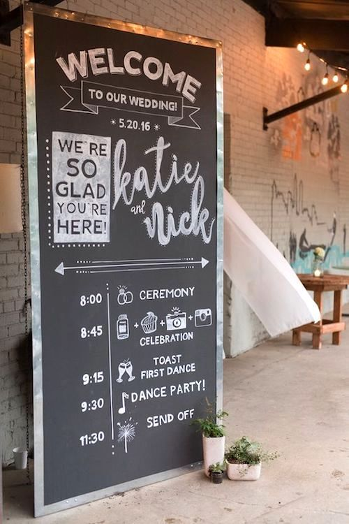 Industrial romantic wedding with hand lettered welcome chalkboard sign.
