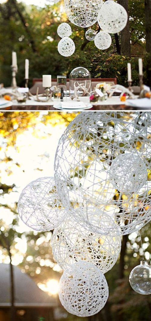 Paper lanterns made with balloons and twine for outdoor backyard weddings.