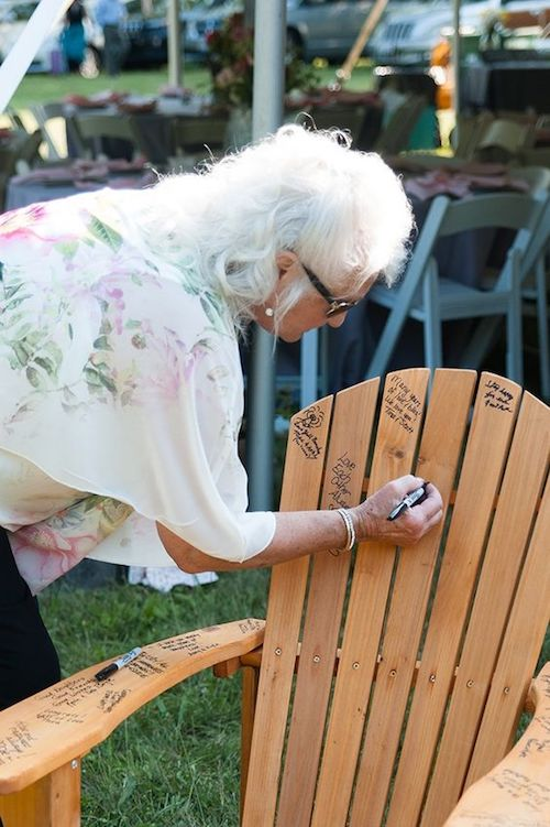 Have your guests sign an Adirondack or a plain lawn chair. That way your guestbook won't end up hidden away in storage.