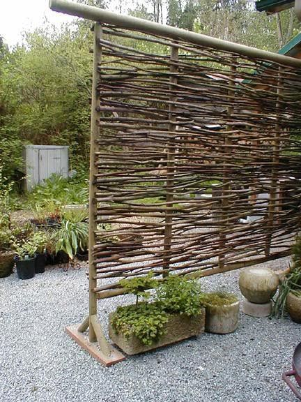 Made from branches, this can be used as a lovely screen to separate yard areas or as a simple photo booth backdrop.