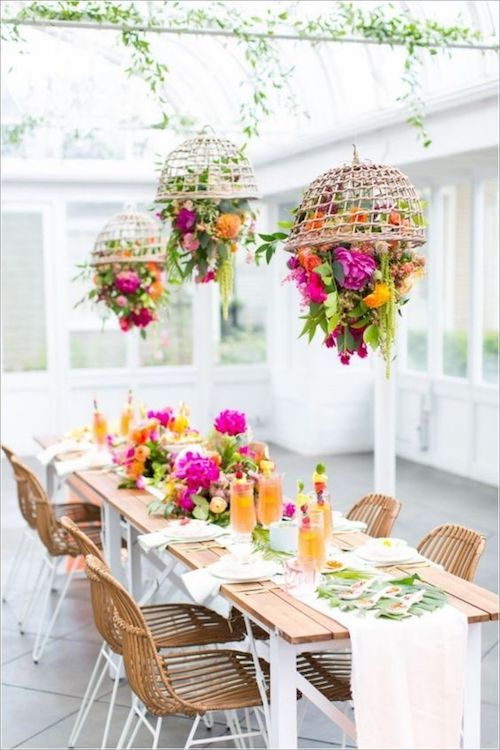 Suspended floral centerpieces for an intimate summer wedding.