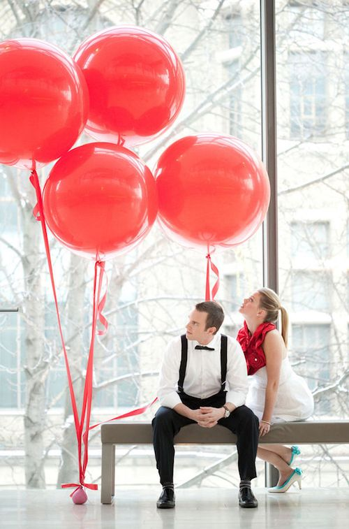 Modern and urban weddings with giant red balloons.