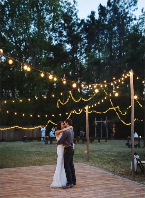 How much space will you spare for the dance floor? Find out how to plan a backyard wedding. Floral decor by Flowers by Frankie and photographed by Clay Austin Photography.