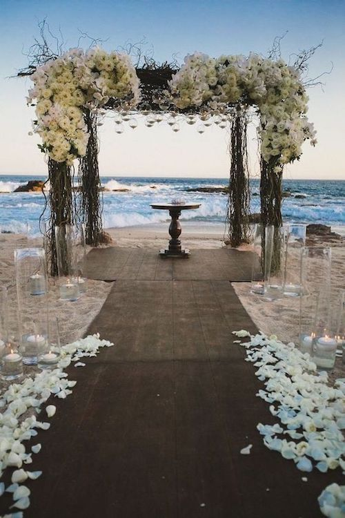 Stunning beach wedding ceremony canopy by Elena Damy.