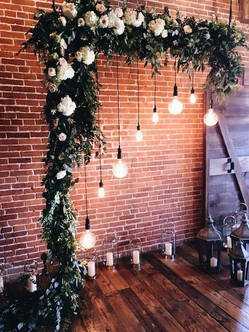 Two pieces of PVC at an angle covered with flowers and greenery for a breathtaking wedding ceremony arch.