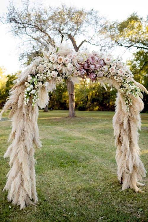 Pampas grass and protea wedding ceremony arch. Photography: Koby Brown.
