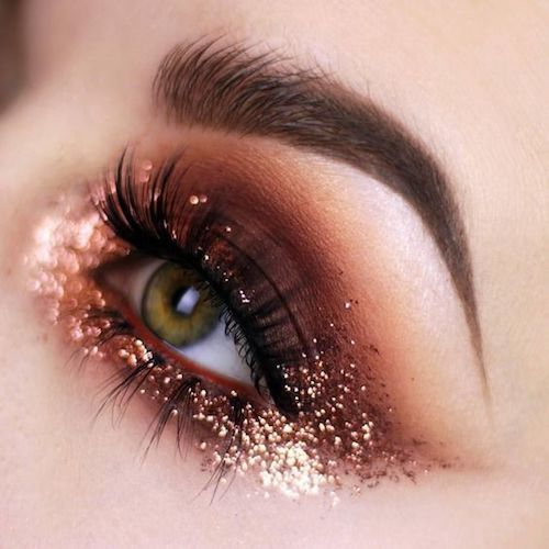 Shimmery eye makeup with long short eyelashes. Wow!
