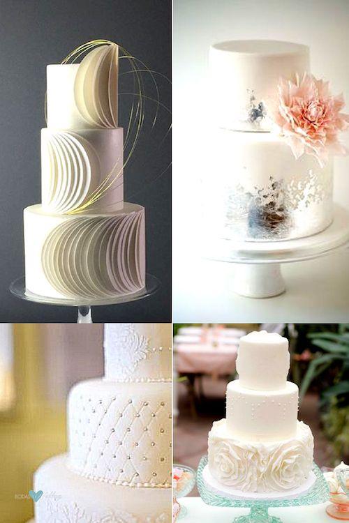 Moderna tarta nupcial en blanco para boda íntima 2019. Clásico con perlas plateadas. Pastel de tres pisos en blanco decorado con rosas y ranúnculos.