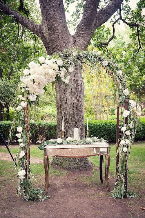 Wedding arch ideas: decorate with Chrisantemums and eucalyptus leaves over a trellis. Photography: Melissa Gidney Photography. Photography Assistant: Vanessa Tierney.