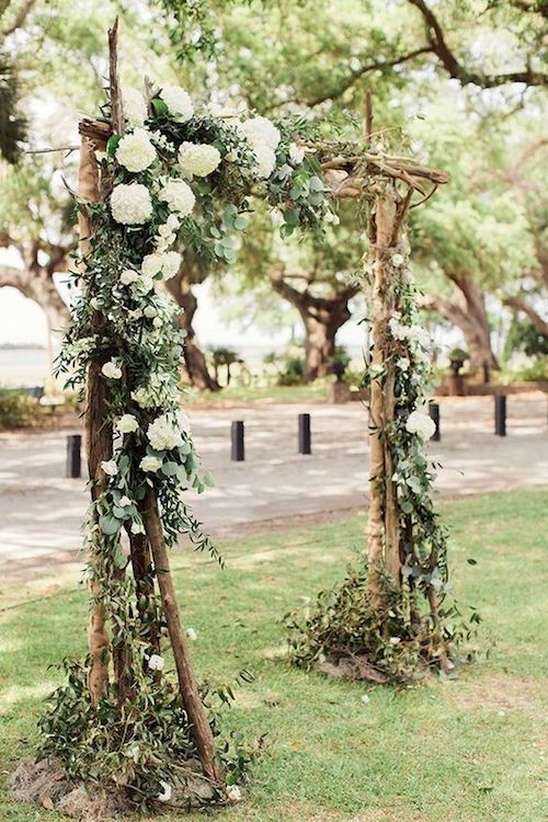 Floral rustic wedding arch ideas for garden weddings.