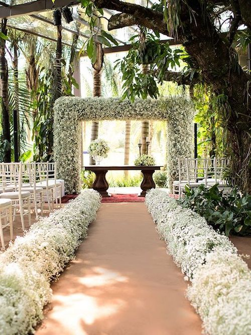 Wedding ceremony arch ideas only found in dreams. Photo Credit: Ana Junqueira.