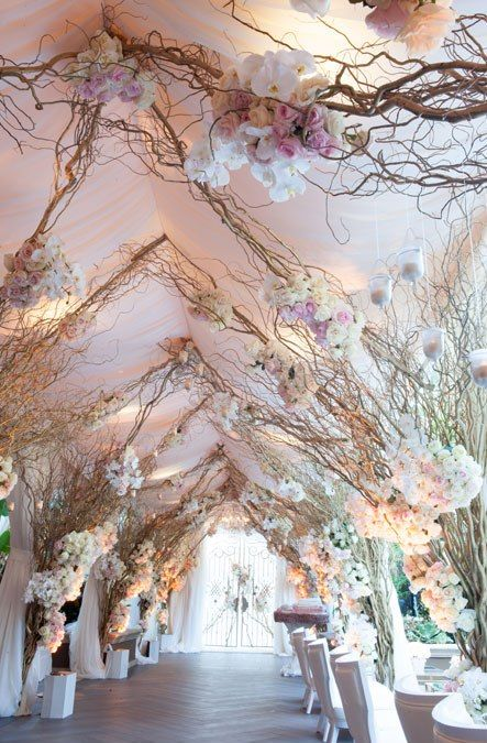 Talk about an entrance for your big day! Willow branches and blooms creation by Mandy Bryant Dewey Seasons Hotel Los Angeles at Beverly Hills wedding.