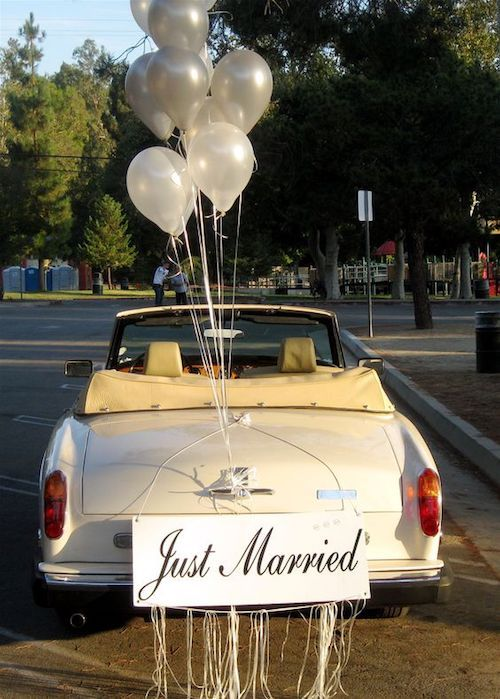 The balloons make this Rolls Royce Corniche convertible look so happy and fun.