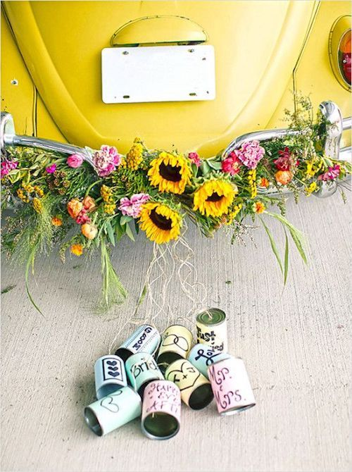 Yellow VW bug getaway ride with DIY colorful cans. Photographed by Two Blue Shoes Photography.