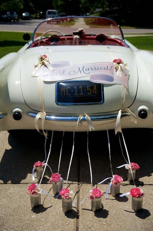 "Perfect car decorations for that ""just married"" ride on a 1954 corvette convertible by Modern day events and floral."