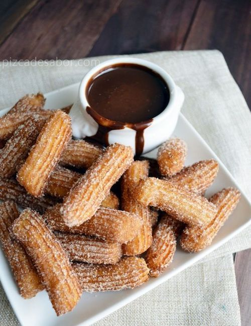 Crunchy and delicious churros with hot chocolate for your wedding reception.