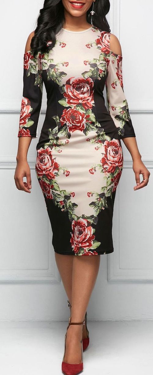 Dark background floral dress with a color blocking play that will make you look 10 lbs. lighter! By Rosewe.