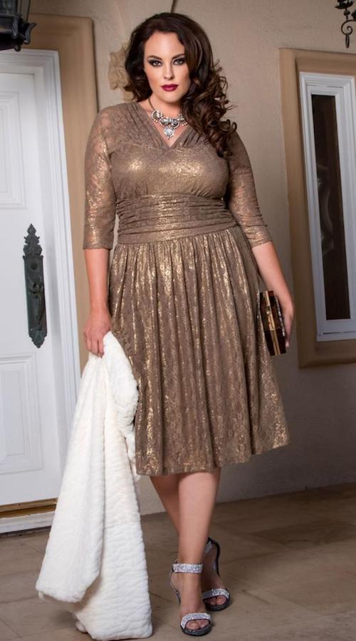 Elegant metallic dress with pleated skirt and three quarter sleeves.
