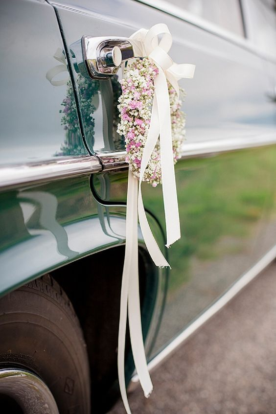 """They have said their """"i Do's"""" surrounded by a magnificent view of the Rhone and now it's time to depart! Floral wedding car decoration for an elegant autumn celebration by Juliane Vatter."""