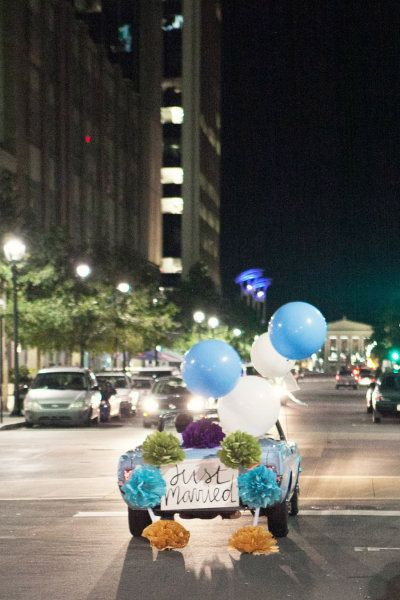 Fun wedding getaway car ideas. Pompons and giant balloons. Photography by Nancy Ray Photography.