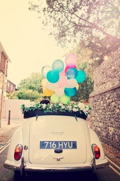 Nothing adds a smile to people's faces more than a bunch of balloons accompanying the newlyweds to their happily ever after.