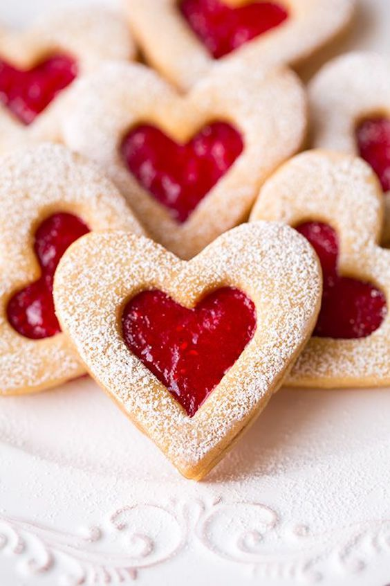 Heart-shaped homemade Linzer cookies with strawberry and raspberry jam. These are my favorites! Cooking Classy.