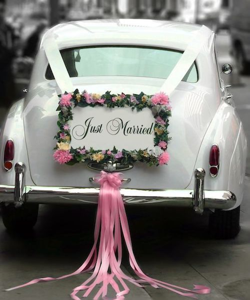 One of the most adorable just married car decoration ideas we have seen. Vintage Rolls Royce.