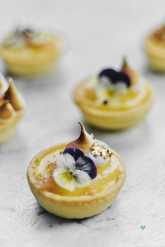 Lemon lime tartlets decorated with posies and a touch of gold.