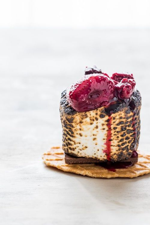 Maybe you cannot roast marshmallows on a campfire but these roasted berry S'mores are the next best thing.