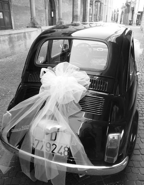 Wedding car decoration with a giant tulle bow.