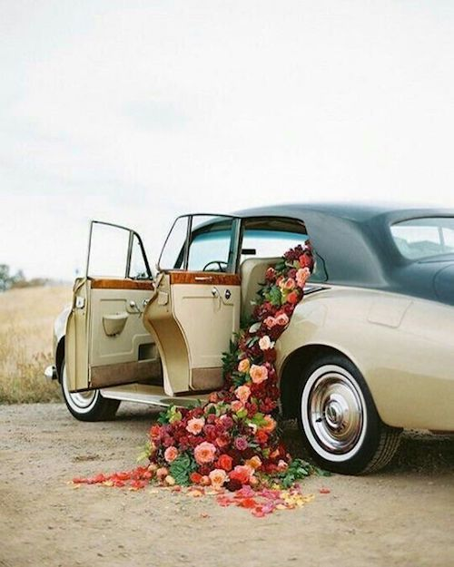 Surprise! Fill the wedding car with flowers!
