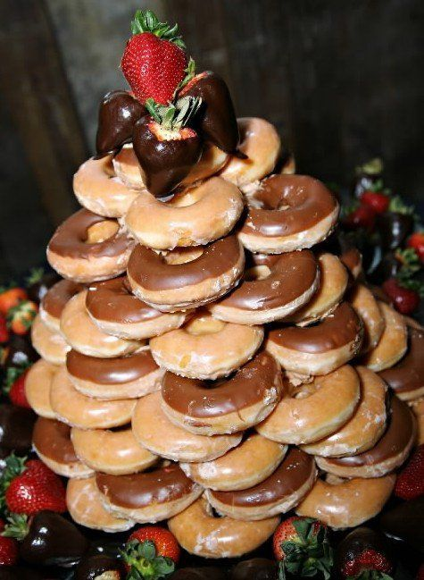 Get inspired by this Krispy Kreme donut tower for the groom's cake. Photo: FotoArt by Leslie.