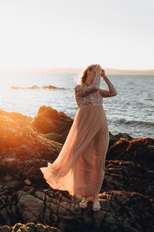 Embrace the new trends and create an ethereal vibe for your bridesmaids with sequin tops and soft chiffon skirts for a beach wedding. Photo: Lucija Ros.