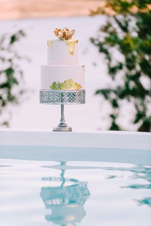 More cake ideas for intimate destination weddings! Two-tiered white cake with gold leaf details by starlettadesigns.
