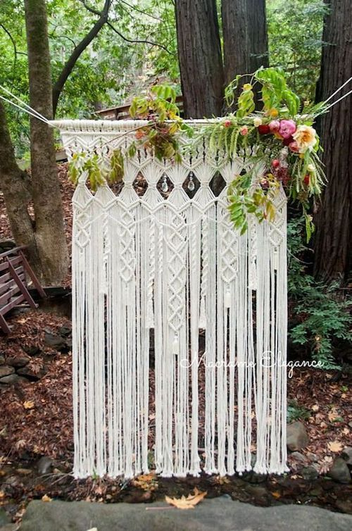 Enchanted forest boho ceremony backdrop.
