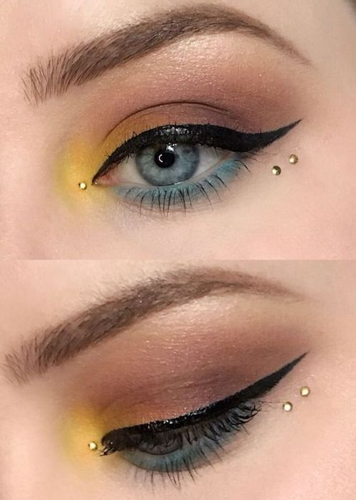 Colorful three toned eye makeup look with blue waterline highlight and black liquid liner for a cat eye.