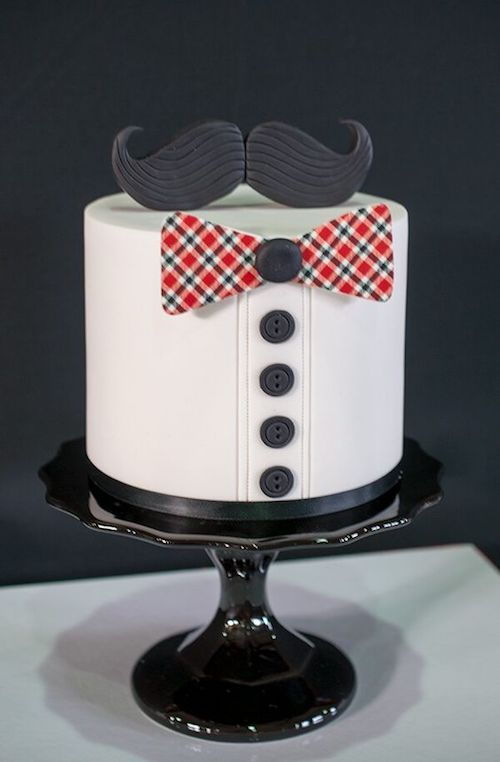 Cute and funny groom's cake with mustache and bow.