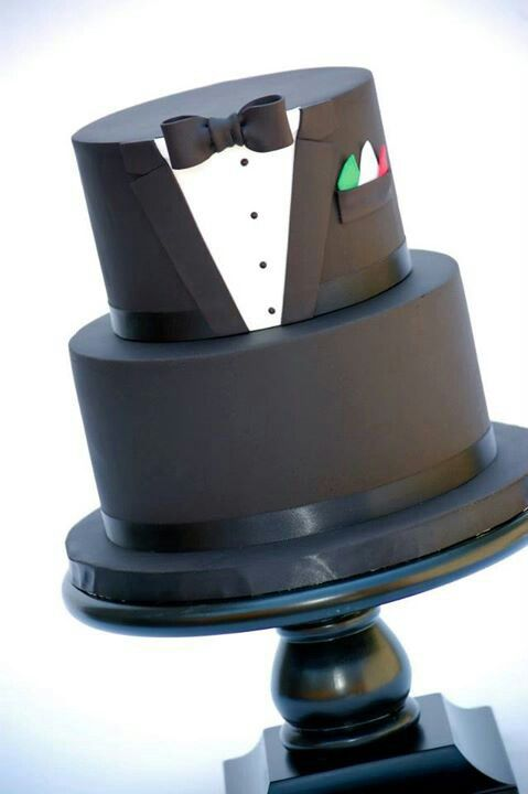Why not give the groom his own cake so that he can share in the spotlight too?