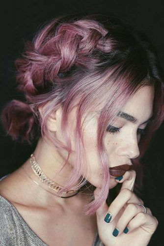 Fresh and fun hairstyle ideas for weddings. Side-swept bangs and braid with pastel pink hair color.