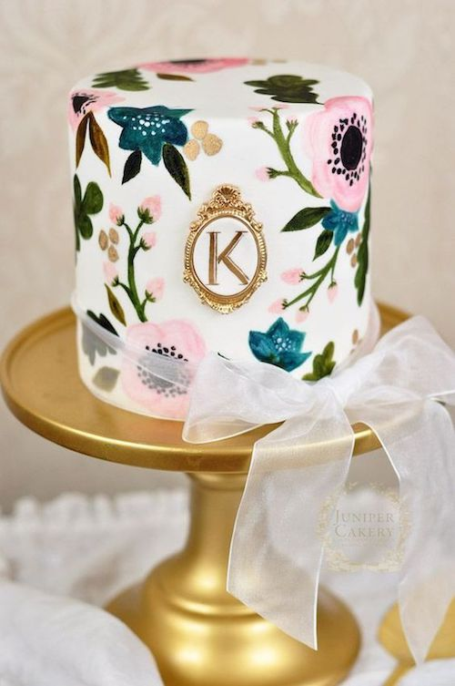 Hand painted floral cake with monogram by Juniper Cakery.