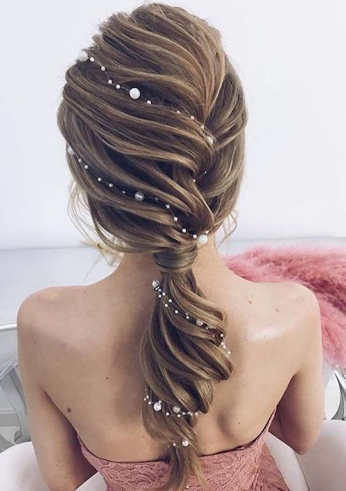 Swoon worthy wrap around the back low ponytail.