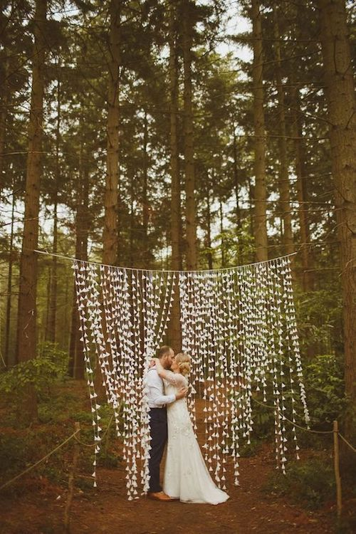 You may spend some time making your own wedding backdrop, but then you get to take it home! Ed Peers Photography.