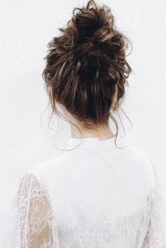 Stunning messy bun, a hair updo classic.